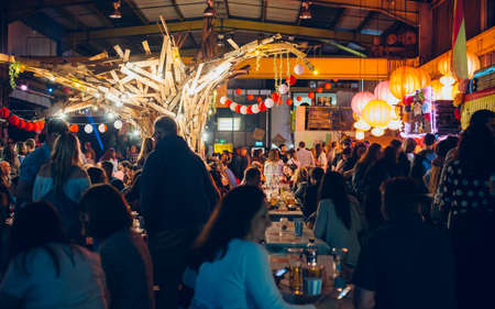 Cardiff, Wales - April 8, 2017: Depot in Cardiff filled with people on spanish food festival, United Kingdom