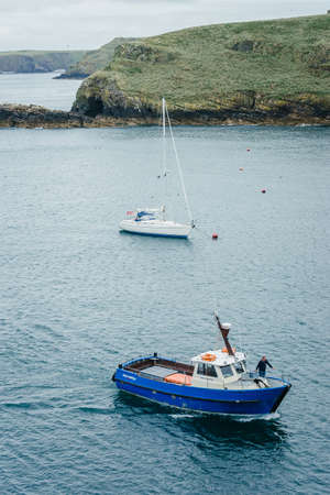 Skomer Island, Wales - July 1, 2017: Dale Princess empty boat ride to pick up people on a cloudy summer day - Martin's Haven Pembrokeshire UK