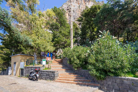 Cefalu, Italy - March 24, 2019: Entrance to Rocca di Cefalù, stairs leading to the pathway to hill top in Cefalu, Sicily.