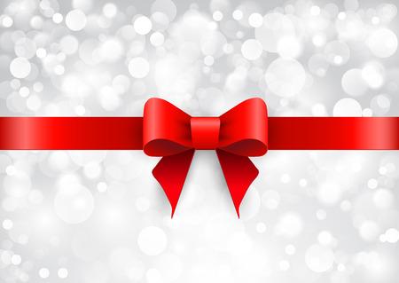 moños navideños: Lazo de satén rojo sobre un fondo brillante