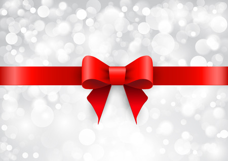 Red satin bow on a brilliant background