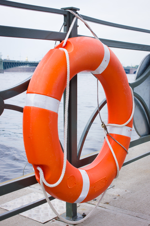 Orange lifebuoy of fast safety. Safety concept. Stock Photo