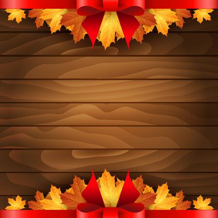 Border of autumn maples leaves decorated with a red bow on a wooden background.