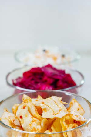 Korean kimchi cabbage, beet sauerkraut and sauerkraut in glass bowl. Probiotics food concept