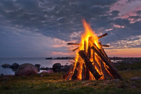 campfires: Bonfire in a white nordic summer night Stock Photo
