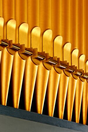 diapason: Fragment of golden organ pipes. Stock Photo