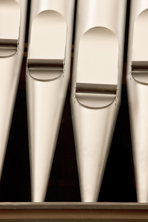 diapason: A close-up  of silver organ pipes.