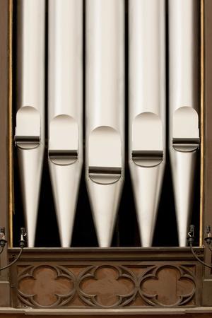 diapason: A close-up  of antique silver organ pipes.