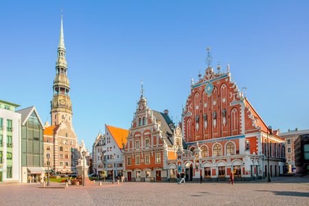 RIGA, LATVIA - September 9, 2008: Tourists admiring Town Hall Square with House of Blackheads and St Peter's church in Riga, Latvia. Editorial