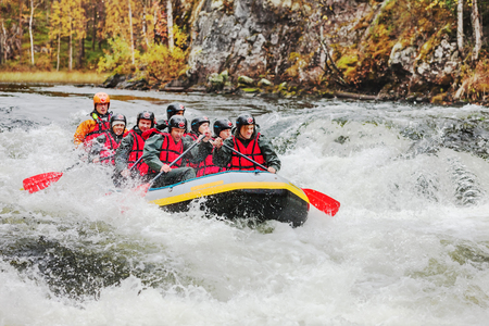 Group of tourists white water rafting on Lapland river