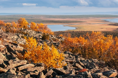 View from the top of a rocky mountain over Lapland landscape in autumn Stock Photo