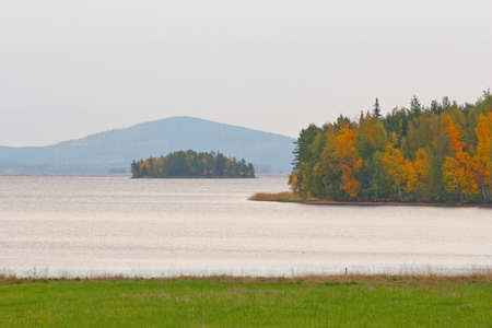 Lapland landscape with a lake and a mountain in autumn
