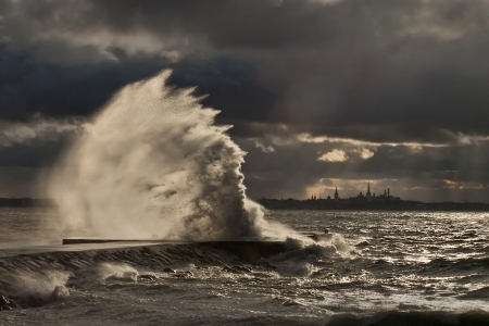 estonia: High wave at the pier in a stormy weather