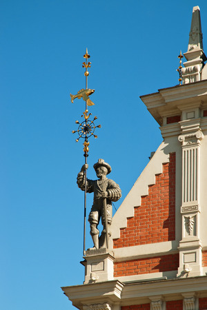 Statue on the corner of the roof of  House of Blackheads, Riga Stock Photo