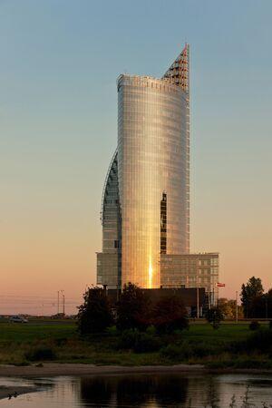 highriser: Modern Riga cityscape by the river Daugava Stock Photo