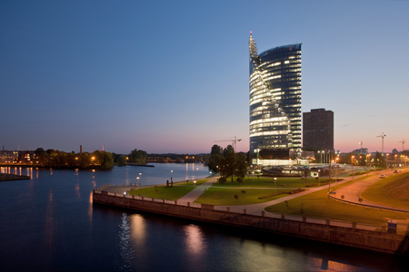 highriser: Modern Riga cityscape by the river Daugava at night