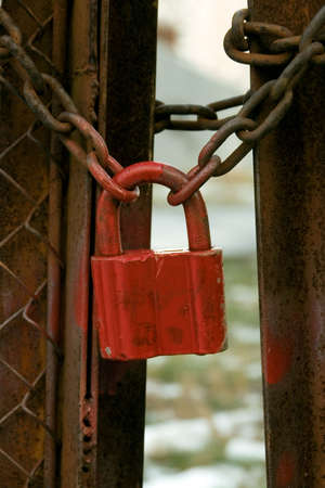catena: Red lock on a rusty chain Stock Photo