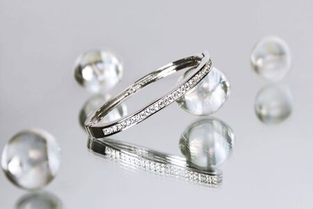 Diamond bracelet among glass beads photo
