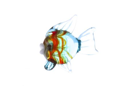 Colorful glass fish on white background photo