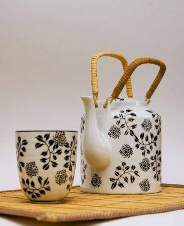 Tea-pot and bowl with green tea photo