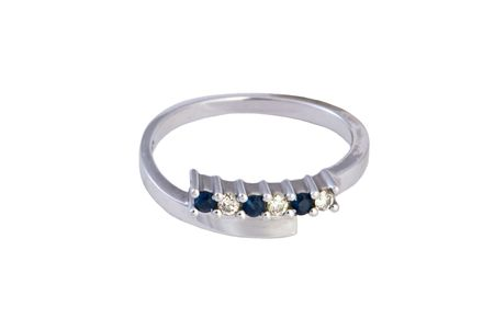 Closeup of the ring with diamonds and sapphires on white background photo