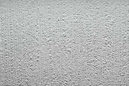 gravelly: Closeup of textured gray wall