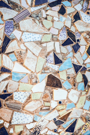 Closeup of neutral colored beige and turquouse abstract mosaic ceramic tiles patterned background