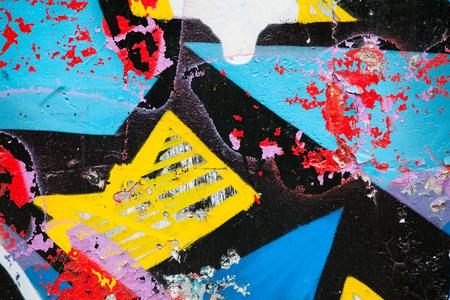 Closeup of damaged colorful graffiti
