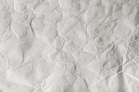 Neutral Texture Background. Crumpled grey craft paper
