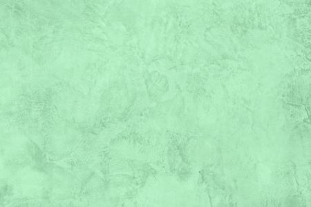 Fond texturé en béton brut à faible contraste de couleur menthe Neo à la mode pour votre concept ou produit. Couleur de l'année 2020