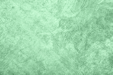 Trendy Neo mint colored low contrast Rough Concrete textured background to your concept or product. Color of the year 2020