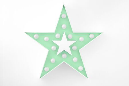 Large trendy mint colored decorative star with lots of lights on white background. Beautiful decor, modern design element.