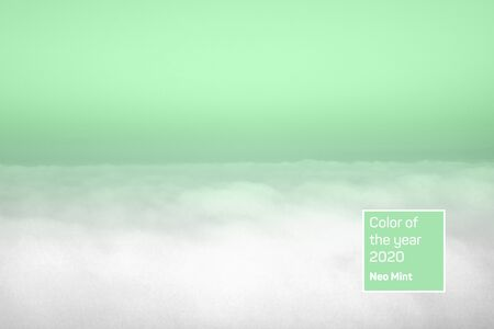 Aerial view of panoramic horizontal clear sky above clouds. Trendy mint toned surreal image. Year color concept.