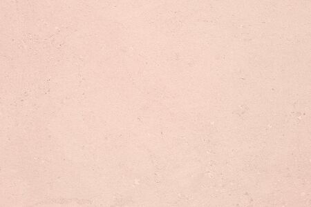 Pale pink colored low contrast Concrete textured background with roughness and irregularities. Autumn Winter 2020 color trend. Фото со стока