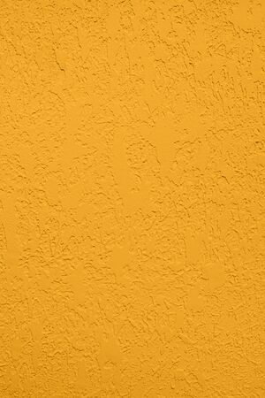 Saturated yellow colored low contrast Concrete textured background with roughness and irregularities to your concept or product. Stok Fotoğraf