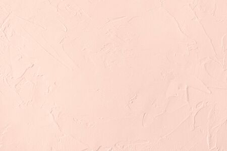 Pale pink colored low contrast Concrete textured background with roughness and irregularities. Autumn Winter 2020 color trend.