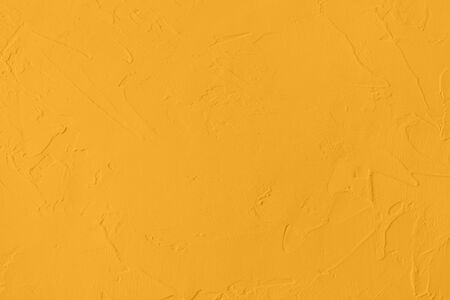 Saturated yellow colored low contrast Concrete textured background with roughness and irregularities to your concept or product. Stock fotó
