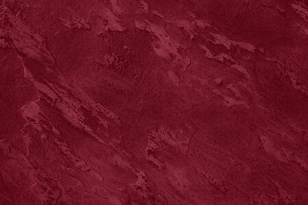 Close up of abstract dark red stone texture with high resolution.