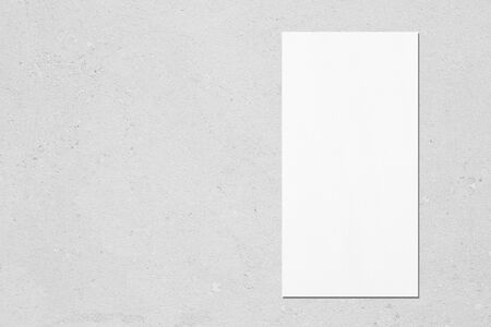 Empty white vertical rectangle price-list or menu mock up with soft shadows on neutral light grey concrete background. Flat lay, top view. Copy space for text.