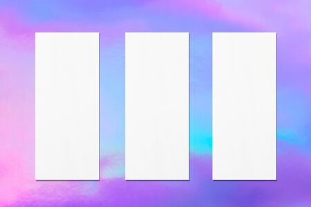 Three empty price-list or menu mock ups with soft shadows on holographic background. Flat lay, top view
