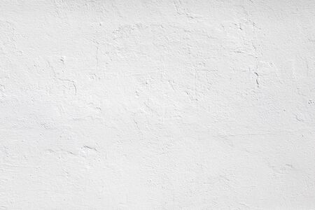Neutral blank low contrast white textured background with roughness and irregularities to your concept or product. White plaster painted on concrete stone wall.