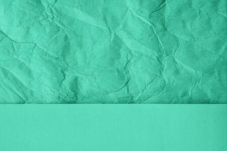 Crumpled and plain paper sheets divided in center creating line partition. Trendy mint colored abstract background design. Flat lay, copy space. Year color concept. Stock fotó
