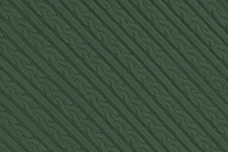 Knitwear Fabric Texture with Pigtails and stripes. Repeating Machine Knitting Texture of Sweater. Dark green Knitted Background. Diagonal composition. 写真素材