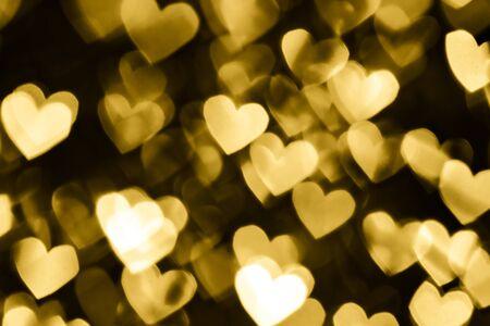 Festive overlay effect. Golden heart bokeh festive glitter background. Christmas, New Year and Valentine's day design Stock Photo