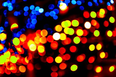 Colorful circles bokeh festive glitter dark background. Holiday greeting cards, invitations, flyers, blog posts, banners design. Christmas lights bokeh overlay.