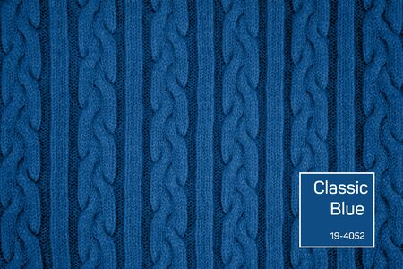Blue Knitwear Fabric Texture with Pigtails and stripes. Repeating Machine Knitting Texture of Sweater. Trendy colored Knitted Background. 2020 color trend text