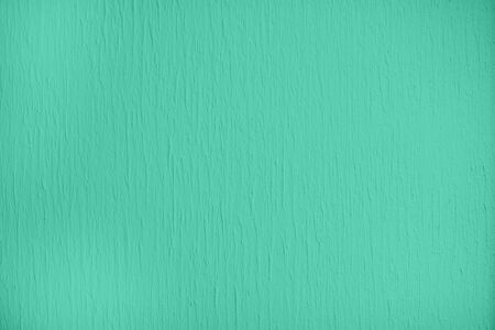 Trendy mint colored low contrast Concrete textured background with roughness and irregularities to your design or product. Color trend concept.
