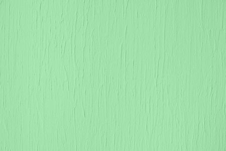 Trendy mint colored low contrast Concrete textured background with roughness and irregularities to your design or product. Year color trend concept.
