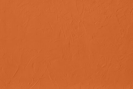 Saturated orange colored low contrast Concrete textured background with roughness and irregularities. 2020 color trend.
