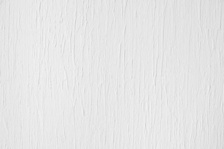 Neutral white colored low contrast Concrete textured background with roughness and irregularities to your concept or product.